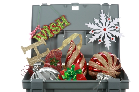 a grey plastic storage box jam packed with colorful christmas or